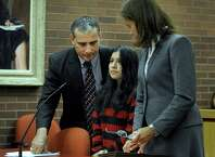 Lidia Quilligana, 31, center, is aided by interpreter Javier Lillo and represented by her attorney Jennifer Tunnard.