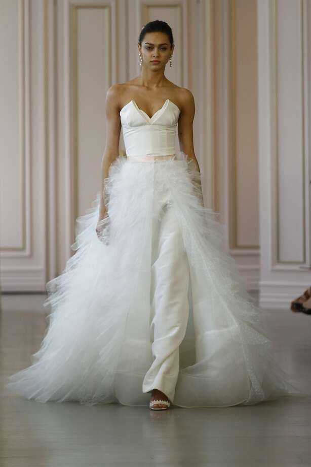2-in-1 gown: The Oscar de la Renta Bridal 2016 collection, the first by new designer Peter Copping, featured several gowns with detachable skirts for versatility. This gown, called the Zhenya, is a white silk faille column gown with a point d'esprit ruffle overskirt. It retails for $9,990. Photo: Courtesy Oscar De La Renta