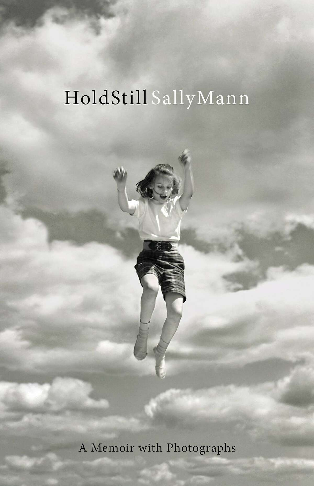 """This book cover image released by Little, Brown and Co. shows """"Hold Still,"""" by Sally Mann. (Little, Brown and Co. via AP) AP PROVIDES ACCESS TO THIS HANDOUT PHOTO TO BE USED SOLELY TO ILLUSTRATE NEWS REPORTING OR COMMENTARY ON THE FACTS OR EVENTS DEPICTED IN THIS IMAGE. THIS IMAGE MAY ONLY BE USED FOR 14 DAYS FROM TIME OF TRANSMISSION; NO ARCHIVING; NO LICENSING."""