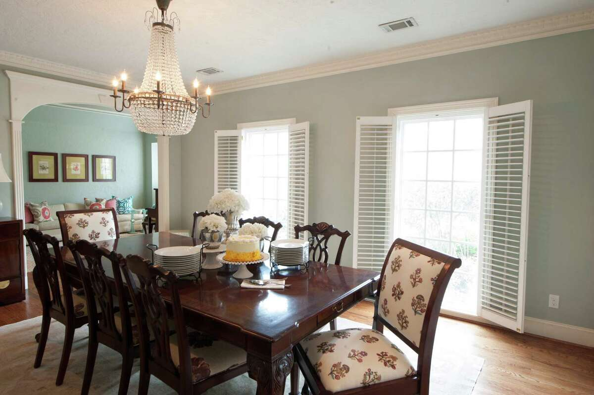 The large dining table was too big for the dining room, so the Minyards turned the formal living room into a dining room. A crystal beaded chandelier from High Fashion Home adds a bit of glamour.
