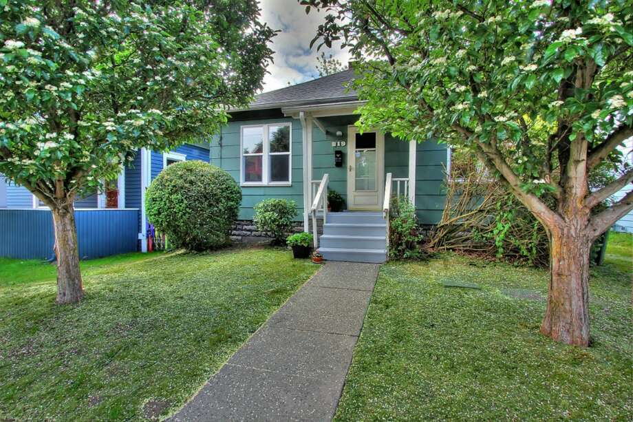 The first home, 819 N.W. 65th St., is listed for $365,000. The two bedroom, one bathroom home was built in 1915 and has been maintained by the same owners since the 1970s. 