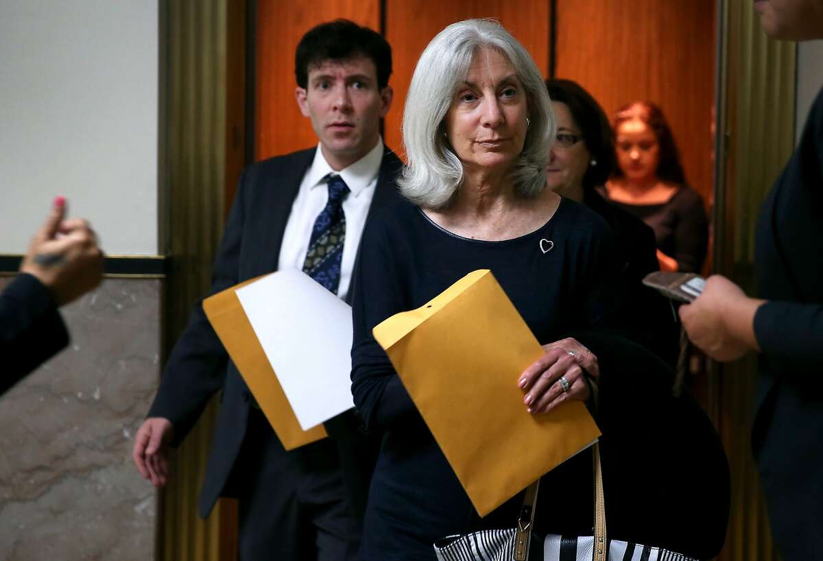 Andrea Cukor and her son Alexander arrive at the Alameda County Superior Courthourse before Daniel DeWitt was formally committed to Napa State Hospital in Oakland, Calif. on Friday, May 29, 2015. DeWitt was found to be mentally ill when he bludgeoned to death Andrea's husband and Alexander's father Peter Cukor in 2012 in front of his Berkeley hills home.