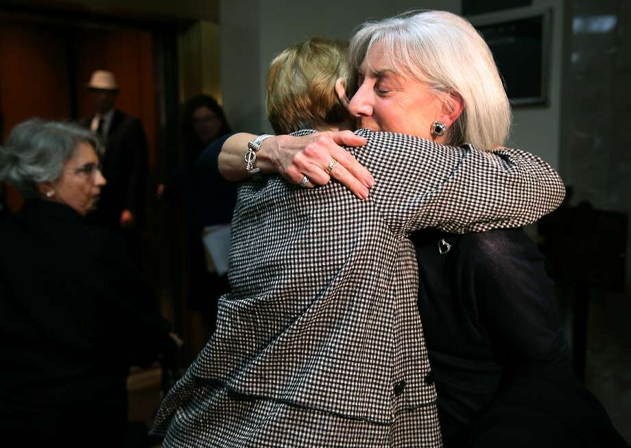 Andrea Cukor (right) hugs a supporter at Alameda County Superior Court after Daniel DeWitt was formally committed to Napa State Hospital in Oakland, Calif. on Friday, May 29, 2015. DeWitt was found to be mentally ill when he bludgeoned to death her husband Peter Cukor in front of their Berkeley hills home in 2012. Photo: Paul Chinn, The Chronicle