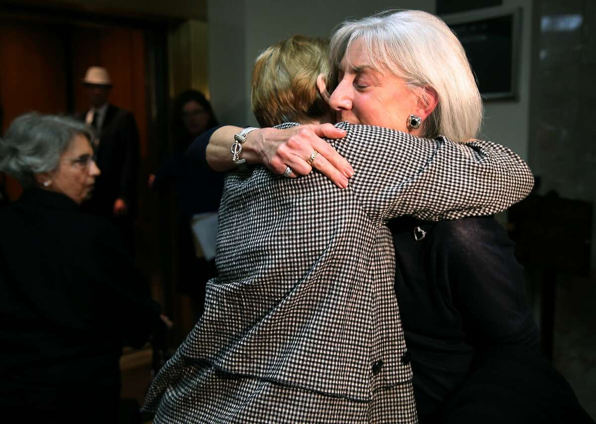 Andrea Cukor (right) hugs a supporter at Alameda County Superior Court after Daniel DeWitt was formally committed to Napa State Hospital in Oakland, Calif. on Friday, May 29, 2015. DeWitt was found to be mentally ill when he bludgeoned to death her husband Peter Cukor in front of their Berkeley hills home in 2012.