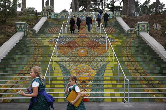 Katherine Delmar Burke School students Lindsey Bailey, 8, and Caroline Batchelder, 9, walk past the new steps leading into Lincoln Park after their unveiling ceremony by Friends of Lincoln Park May 28, 2015 in San Francisco, Calif. Friends of Lincoln Park is the organization that made the stairs happen.