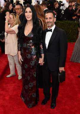"Cher and Marc Jacobs attend the ""China: Through The Looking Glass"" Costume Institute Benefit Gala at the Metropolitan Museum of Art on May 4, 2015 in New York City.  The iconic 69 year old singer will be the face of the designer's fall 2015 campaign."