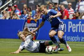 SAN JOSE, CA - MAY 10:  Lori Chalupny #16 of the United States works around Julie Ann Russell #11 of Ireland during their international friendly match on May 10, 2015 at Avaya Stadium in San Jose, California.  The U.S. won 3-0.  (Photo by Brian Bahr/Getty Images)