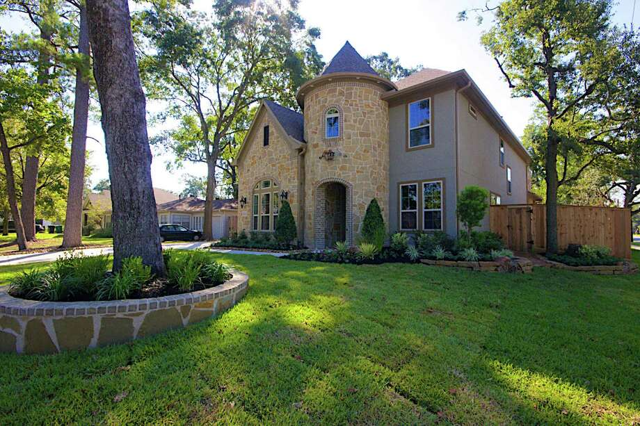 "Homes like this one in Houston's Oak Forest neighborhood practically shout ""suburb."""