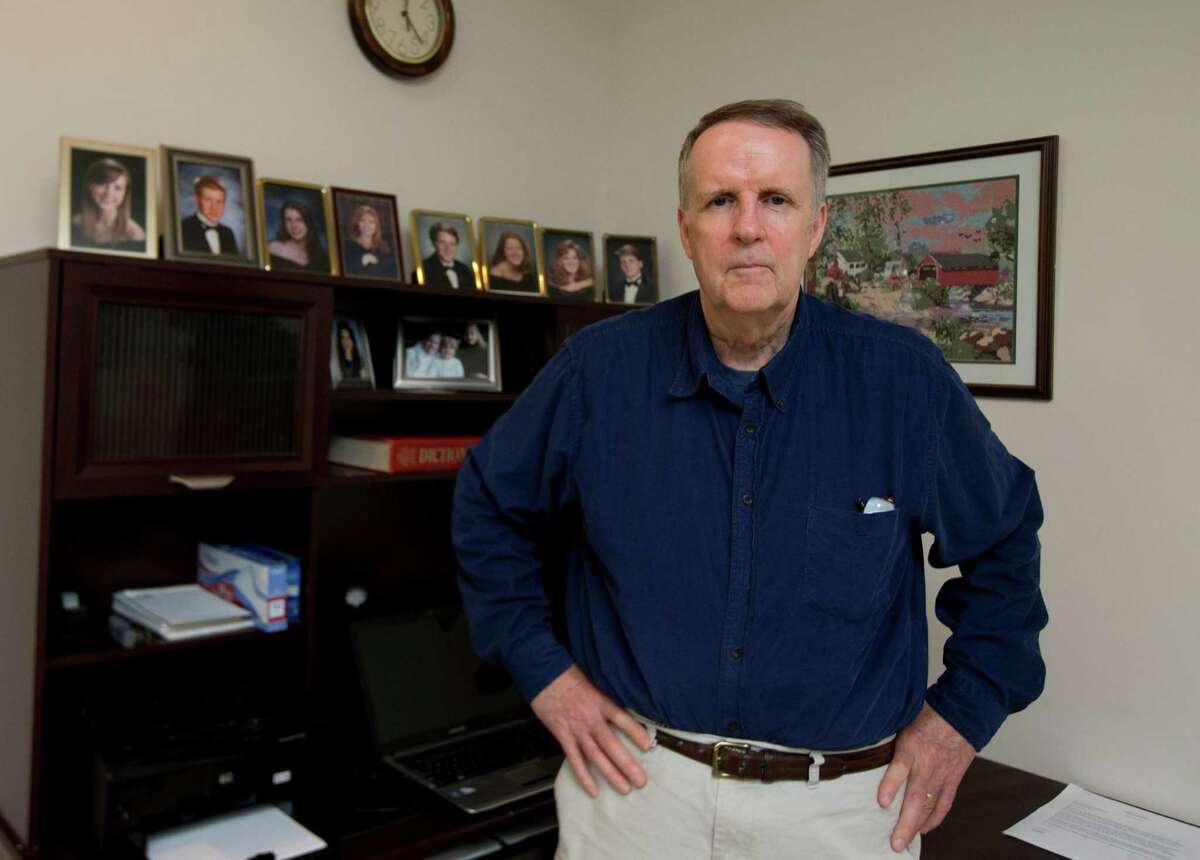 John Ryan poses for a picture in his office at his house in Aldie, Va., Friday, May 29, 2015. For the first time, a major study has shown that a drug targeting the body's disease-fighting immune system may improve survival for the most common form of lung cancer. Ryan was diagnosed with incurable lung cancer two years ago. Standard cancer medicine left him exhausted, prone to infections and did little to shrink the tumor. In October 2013 he joined the immunotherapy study and was randomly assigned to get Opdivo. Three months later his tumor had been reduced by 65 percent and he felt well enough to help his son cut down a large tree for firewood. (AP Photo/Manuel Balce Ceneta)