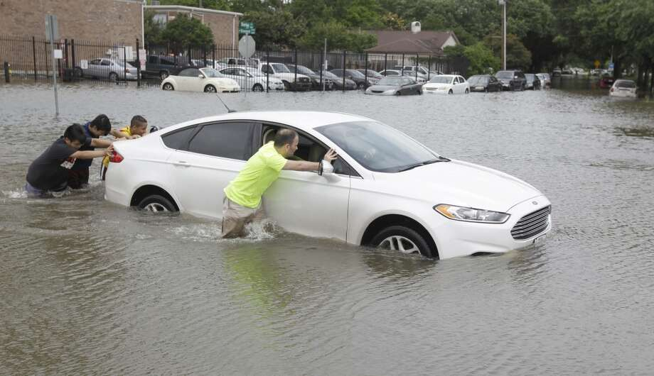 """Do NOT drive into water over your car's tailpipe. But if you do, and the engine goes dead, do NOT restart it - that'll suck water into the engine."" Photo: Houston Chronicle"