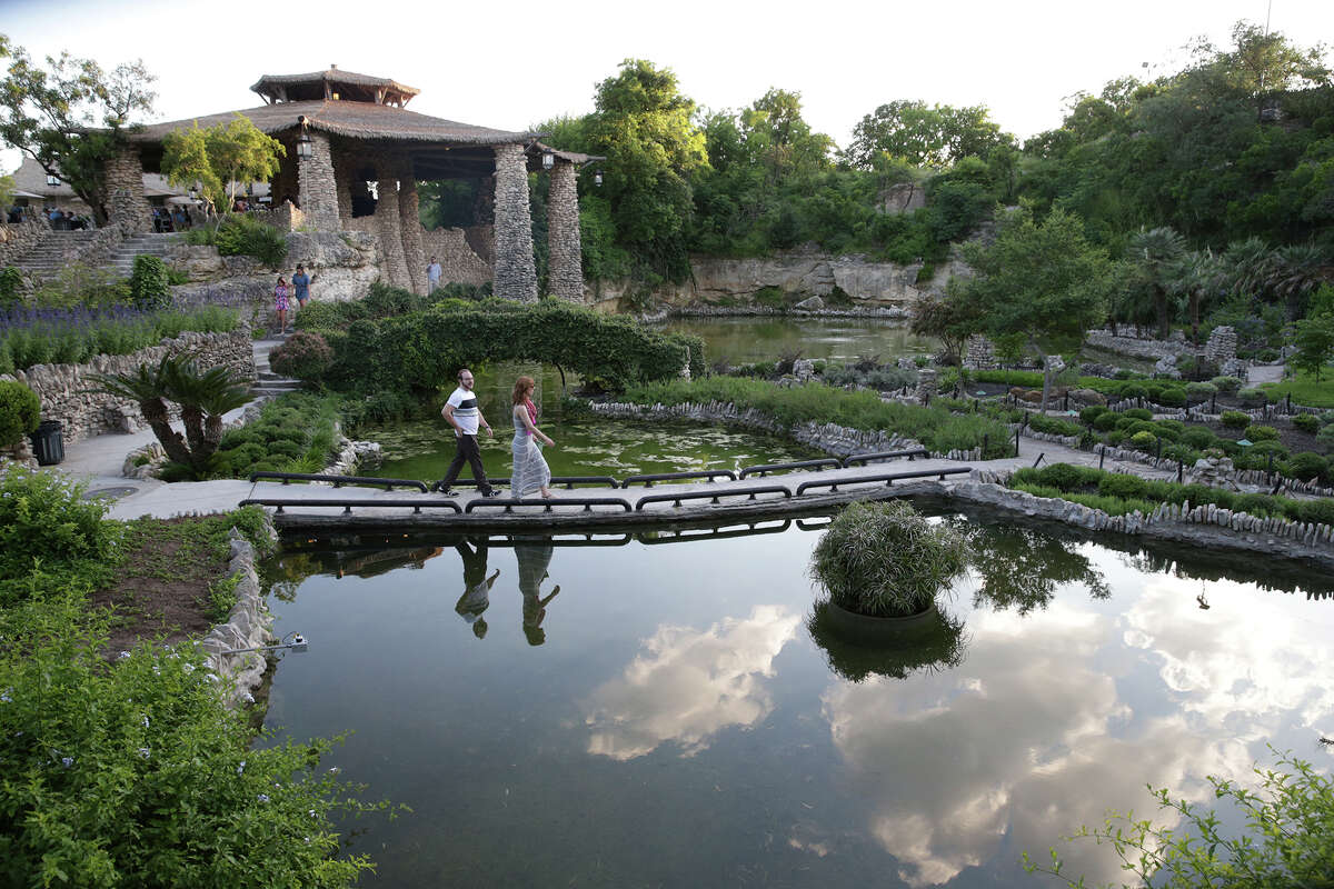 Spectators look over the scenery as the Japanese Tea Garden in Brackenridge Park opens for jazz music entertainment on May1.