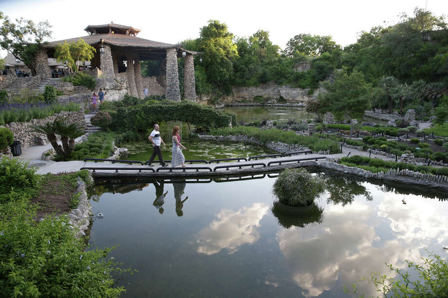 Spectators look over the scenery as the Japanese Tea Garden in Brackenridge Park opens for jazz music entertainment on May1. Photo: Tom Reel /San Antonio Express-News