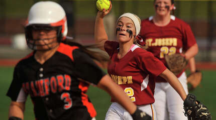 St. Joseph's Hanna Errico attempts to catch Stamford's Maddie Santora between first and second base during their FCIAC championship softball game at Sacred Heart University in Fairfield, Conn., on Friday, May 29, 2015. St. Joseph won, 2-1.