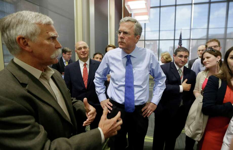 """Jeb Bush wants to """"take out"""" the Islamic State, in cooperation with other countries — which sounds a lot like Obama's policy. Asked whether more American troops are needed, Bush says he would rely on his military advisers to make that determination. Photo: Carlos Osorio /Associated Press / AP"""