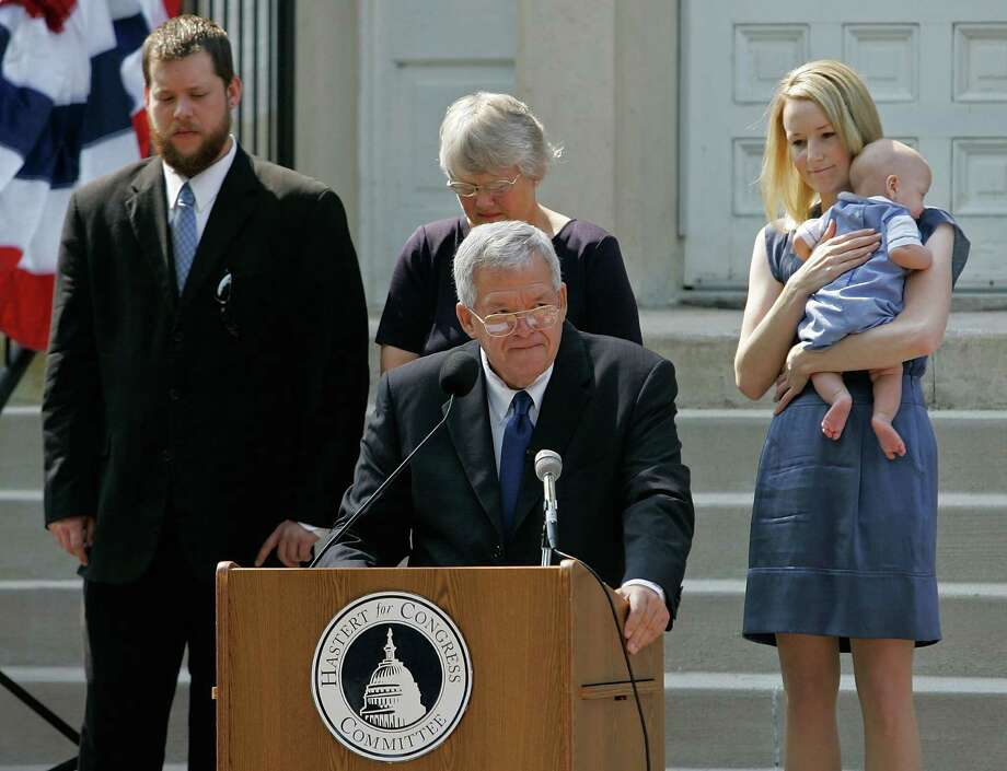 "FILE - In this  Aug. 17, 2007, file photo, Rep. J. Dennis Hastert, front, R-Ill., announces that he will not seek reelection for a 12th term as he stands on the steps of the old Kendall County courthouse with, from left, his son Josh; wife Jean; and daughter-in-law Heidi, grandson Jack, in Yorkville, Ill.  A newly unveiled indictment against Hastert released Thursday, May 28, 2015,  accuses the Republican of agreeing to pay $3.5 million in hush money to keep a person from the town where he was a longtime schoolteacher silent about ""prior misconduct.""  (AP Photo/Brian Kersey, File) Photo: Brian Kersey, STR / Associated Press / AP"