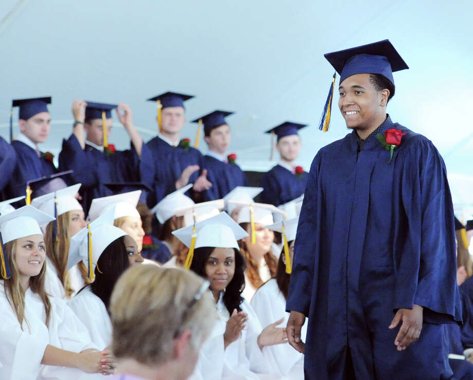 At right, King Low Heywood Thomas School graduating senior Cameron Aaron Burns during commencement at the school in Stamford, Conn., Friday, May 29, 2015. Photo: Bob Luckey / Greenwich Time