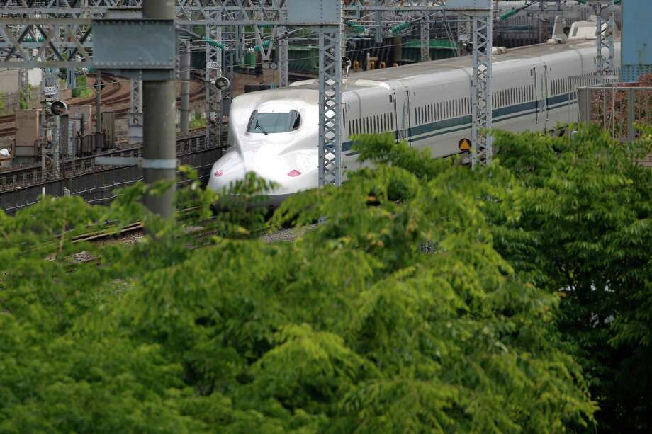 This file photo shows a Japanese high-speed rail train. A proposed high-speed rail between Houston and Dallas worries ranchers, who say eminent domain is needed for the project. Photo: Bloomberg File Photo / © 2015 Bloomberg Finance