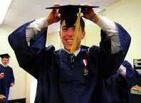 Notre Dame of Fairfield's Class of 2015 Commencement Exercises in Fairfield, Conn., on Friday May 29, 2015. Graduate Nick Carlotto gets ready.