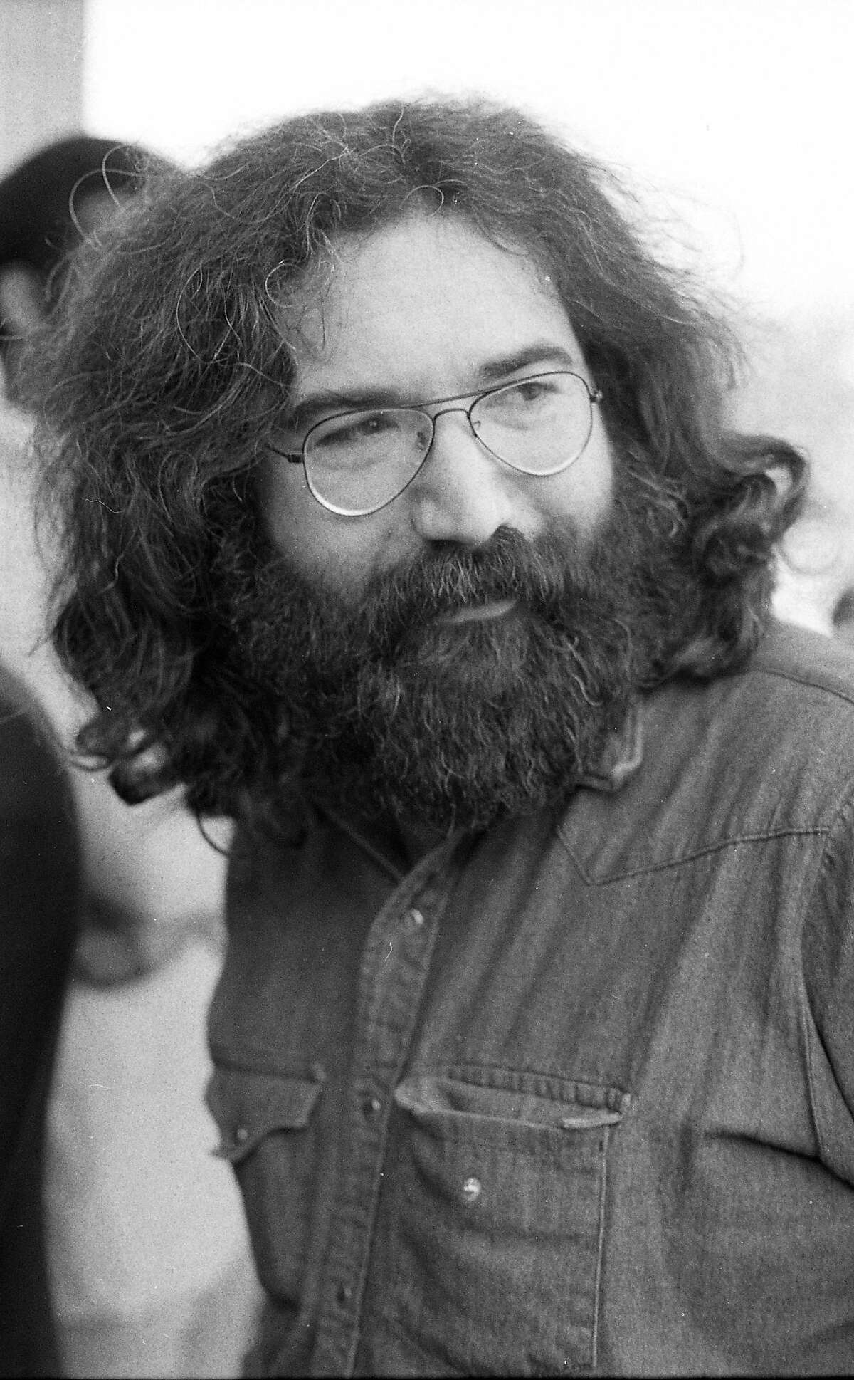 """Jerry Garcia of the Grateful Dead at the March 12, 1973 funeral of Ron """"Pig Pen"""" McKernan, singer and drummer with the Dead."""