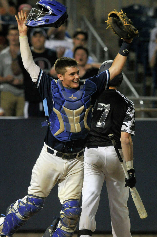Wilton catcher Alex Jacobson throws his helmet into the air as Staples' Sean Clarke walks away after striking out to end the game during the their FCIAC championship baseball game at Harbor Yard in Bridgeport, Conn., on Friday, May 29, 2015. Wilton won, 1-0, in the eighth. Photo: Jason Rearick / Stamford Advocate