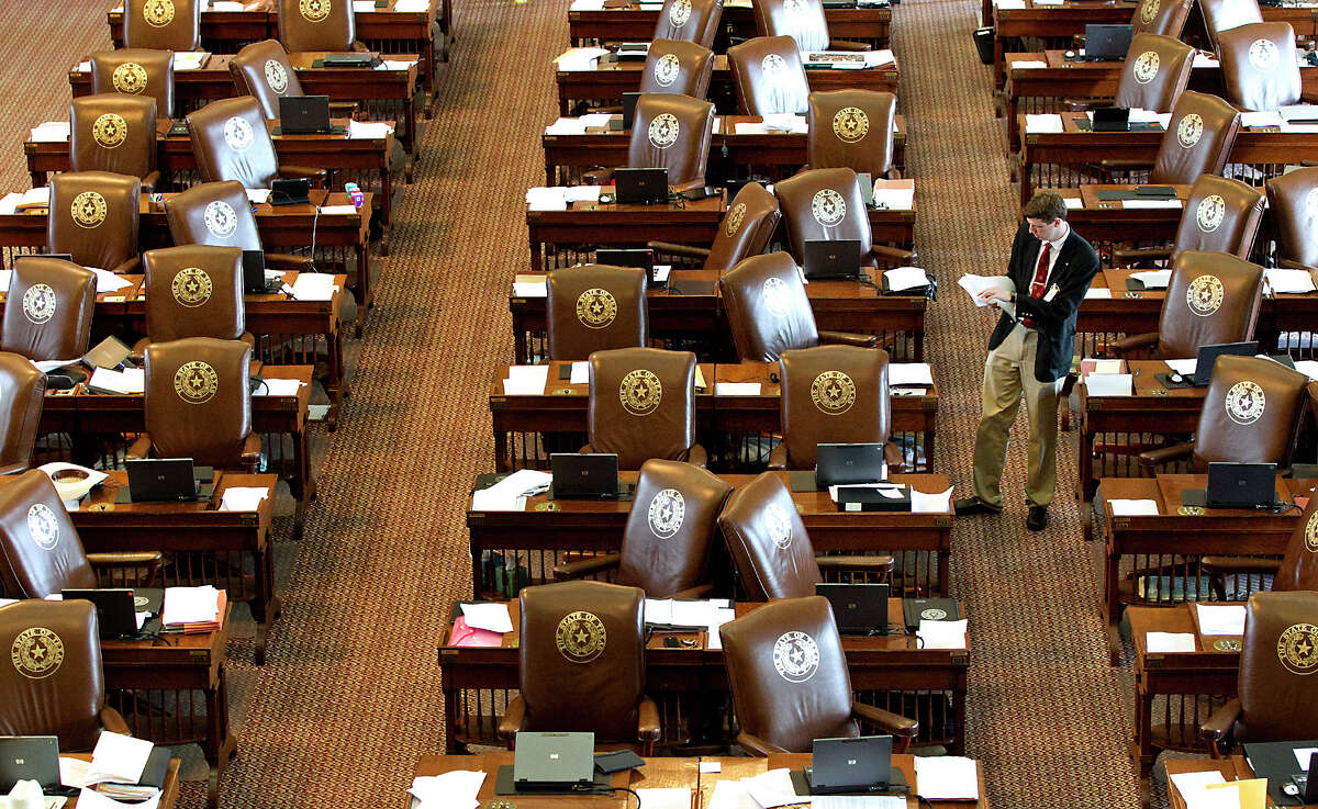 Updated resolutions are placed on empty desks in the House.