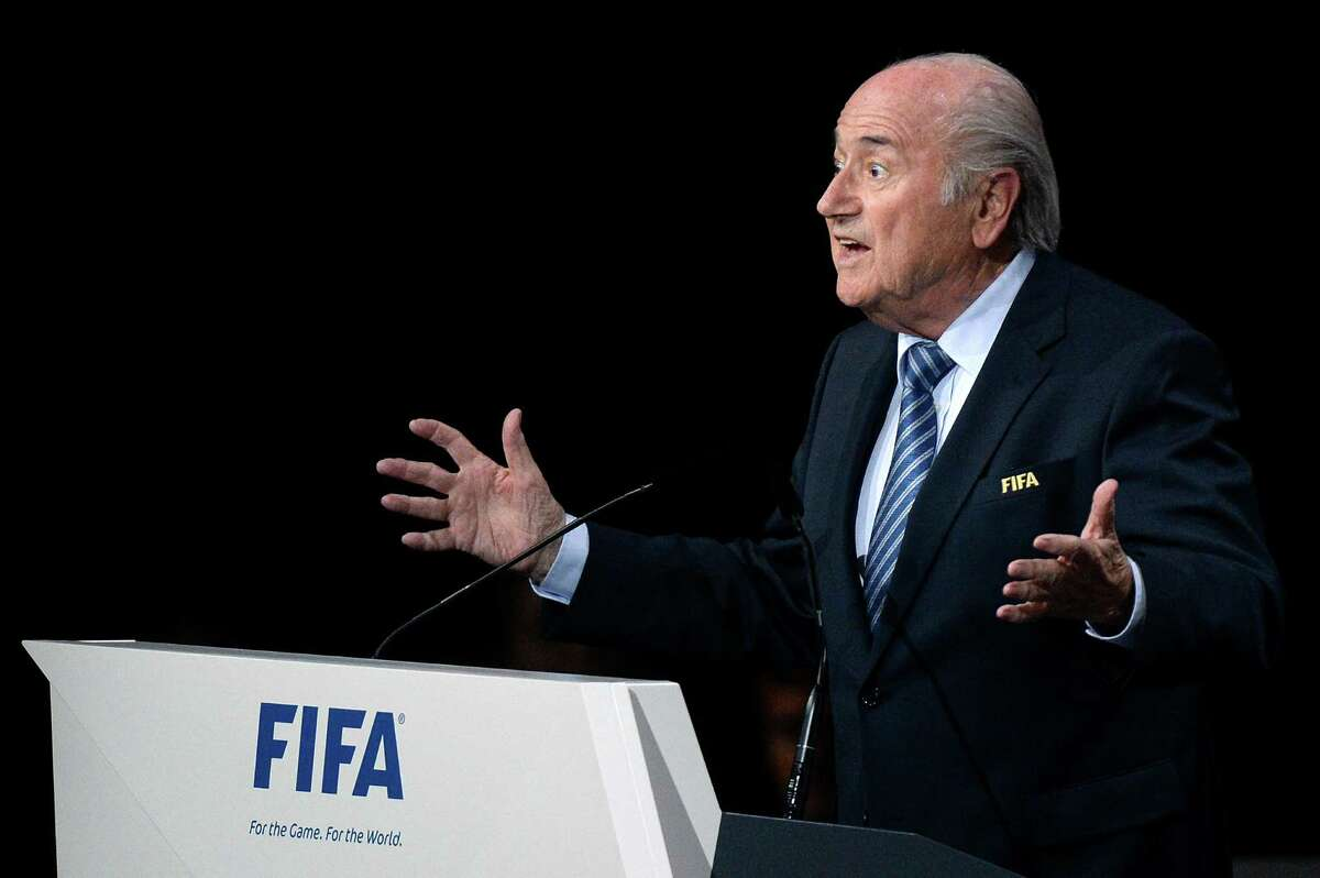 FIFA president Sepp Blatter gestures after his re-election during the 65th FIFA Congress held at the Hallenstadion in Zurich, Switzerland, Friday, May 29, 2015. Blatter has been re-elected as FIFA president for a fifth term, chosen to lead world soccer despite separate U.S. and Swiss criminal investigations into corruption. The 209 FIFA member federations gave the 79-year-old Blatter another four-year term on Friday after Prince Ali bin al-Hussein of Jordan conceded defeat after losing 133-73 in the first round. (Walter Bieri/Keystone via AP) ORG XMIT: WB751