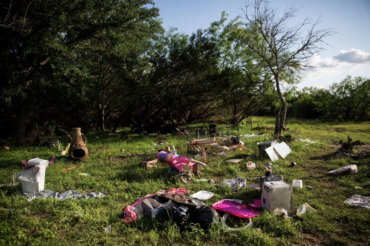 The Bamberger family's yard is covered in debris in Blanco, Texas on May 29, 2015.