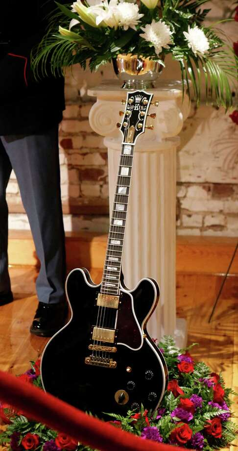 "B.B. Kings' guitar ""Lucille,"" sits among the flowers that ring King's coffin during a public viewing Friday, May 29, 2015 in the B.B. King Museum and Delta Interpretive Center in Indianola, Miss. The visitation comes a day before the funeral for the man who influenced generations of singers and guitarists. King died May 14 at his home in Las Vegas. He was 89. Photo: Rogelio V. Solis, Associated Press / AP"