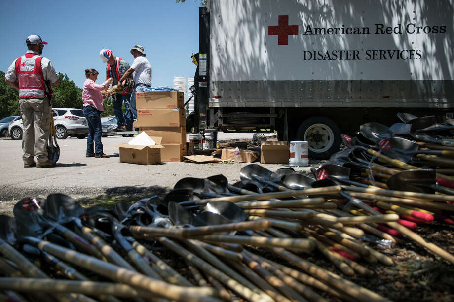 American Red Cross volunteers load a truck with shovels and other supplies for flood victims at the Wimberley Community Center in Wimberley, Texas on Friday, May 29, 2015. Photo: Carolyn Van Houten, Staff / San Antonio Express-News / 2015 San Antonio Express-News
