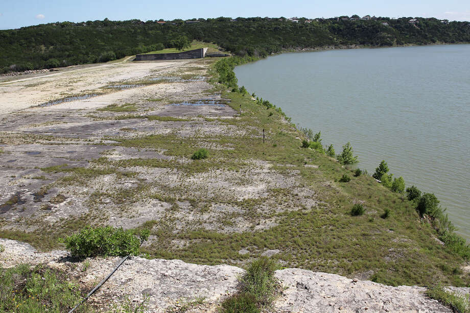 FILE PHOTO — Canyon Lake water  approaches the spillway elevation of 943 feet above sea level in May 2015. On Wednesday, June 21, 2017, officials pulled two bodies from opposite ends of Canon Lake.  Photo: Tom Reel / San Antonio Express-News