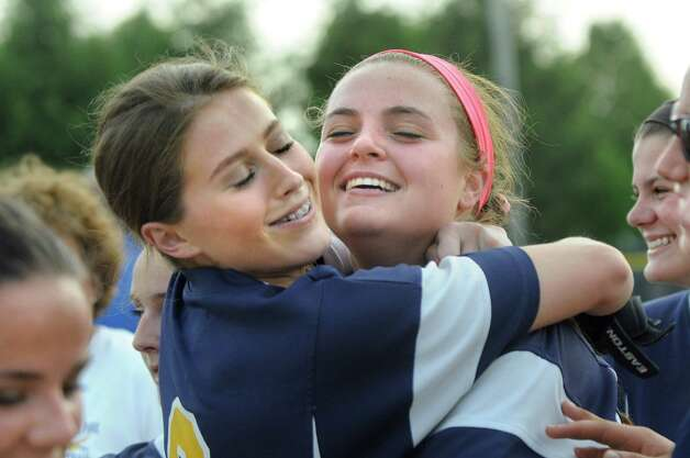 Averill Park's McKenzie Bump, left, hugs Caraline Wood, who hit in the winning run, as they celebrate their dramatic 3-2 win over Troy in the Class A softball final on Friday, May 29, 2015, at Clifton Common in Clifton Park, N.Y. (Cindy Schultz / Times Union) Photo: Cindy Schultz / 00032082A