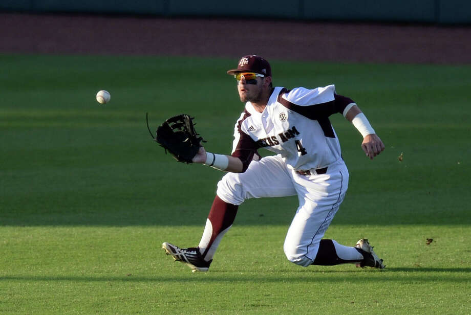 Texas A&M's Nick Banks makes a sliding catch to end the top of the sixth inning during an NCAA college baseball tournament regional game against Texas Southern in College Station, Texas, Friday, May 29, 2015. (Sam Craft/College Station Eagle via AP) Photo: Sam Craft, MBR / Associated Press / College Station Eagle