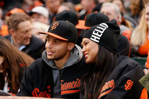 SAN FRANCISCO, CA - MAY 29: Steph Curry of the Golden State Warriors and his wife Ayesha watch the Atlanta Braves play the San Francisco Giants at AT&T Park on May 29, 2015 in San Francisco, California.  (Photo by Lachlan Cunningham/Getty Images)