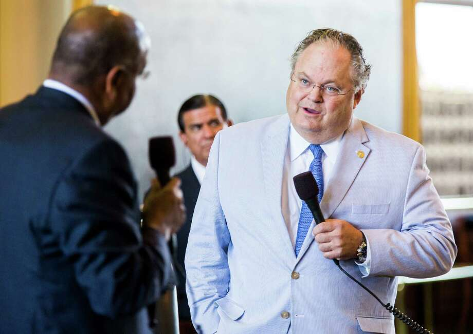 Sen. Craig Estes, R-Wichita Falls, right, and Sen. Rodney Ellis, D-Houston, talk about open carry legislation during the final days of the 84th Texas legislature's regular session on Friday, May 29, 2015, at the Texas state capitol in Austin, Texas. Estes sponsored the bill in the Senate. Open carry in Texas is just a signature away from becoming law, as the House and Senate voted in rapid succession Friday to send the contentious bill to Gov. Greg Abbott. The measure would allow licensed Texans to openly carry handguns in belt or shoulder holsters. (Ashley Landis/Dallas Morning News/TNS) Photo: Ashley Landis, MBR / McClatchy-Tribune News Service / Dallas Morning News