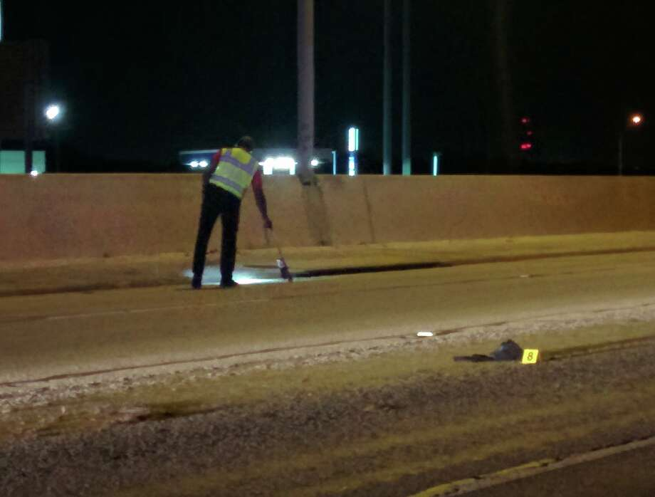 Police investigate an accident scene at the I-10 overpass and Houston Street on May 29, 2015. Photo: Jacob Beltran