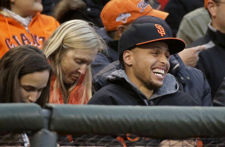 Golden State Warriors guard Stephen Curry laughs while being introduced during the second inning of baseball game between the San Francisco Giants and the Atlanta Braves on Friday, May 29, 2015, in San Francisco. (AP Photo/Eric Risberg) Photo: Eric Risberg, Associated Press