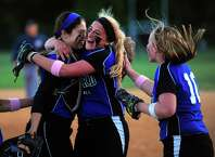 Oxford pitcher Ashley Guillette, center, hugs catcher Kaley Kempf after the team beat Seymour 1-0 after fourteen innings, during softball action in Seymour, Conn. on Wednesday May 13, 2015. At right is Oxford's Allyson Sweeney.