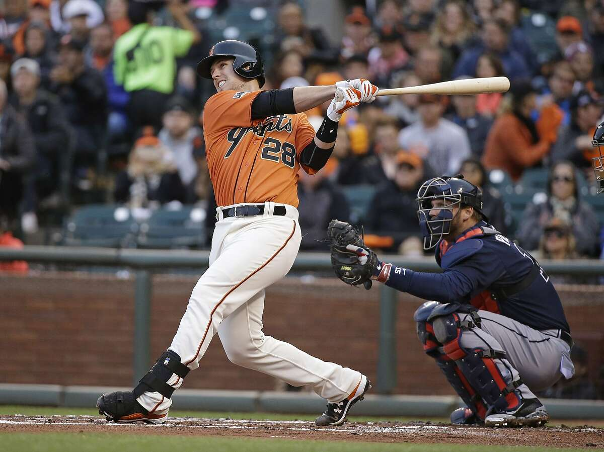 San Francisco Giants' Buster Posey hits a two-run home run off Atlanta Braves starting pitcher Mike Foltynewicz as Braves catcher A.J. Pierzynski watches during the first inning of a baseball game Friday, May 29, 2015, in San Francisco. (AP Photo/Eric Risberg)