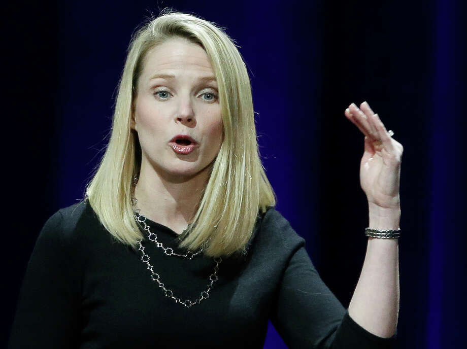 In this Feb. 19, 2015 photo, Yahoo President and CEO Marissa Mayer delivers the keynote address at the first-ever Yahoo Mobile Developer's Conference, in San Francisco. Mayer was the highest paid female CEO in 2014, according to a study carried out by executive compensation data firm Equilar and The Associated Press. (AP Photo/Eric Risberg) Photo: Eric Risberg, STF / AP