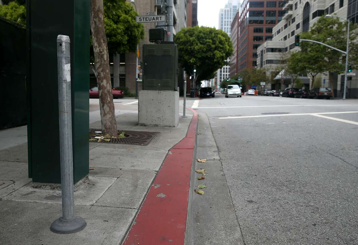 Only the posts remain on a short block of Howard Street between The Embarcadero and Steuart Street in San Francisco, Calif. on Saturday, May 30, 2015 where parking meters once collected cash. The city is pulling out over 1,700 parking spaces to make room for various street improvements.