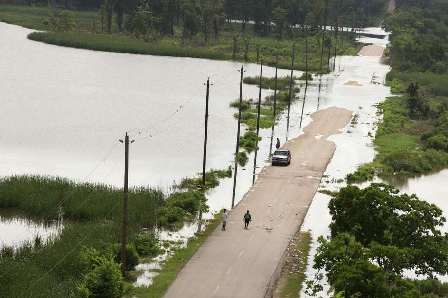 A fresh analysis found 2015 floods could cost Texas more than $3 billion. See photos of the historic floods that swamped Texas this year and in years past... Photo: Brett Coomer, Houston Chronicle / © 2015 Houston Chronicle