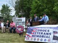 Randy Koniowka, deputy clerk of the Albany County Legislature, details plans for the Cohoes Veterans Memorial proposed for the south side of West End Park on Columbia Street in Cohoes on May 30, 2015. (Brittany Horn/Times Union)