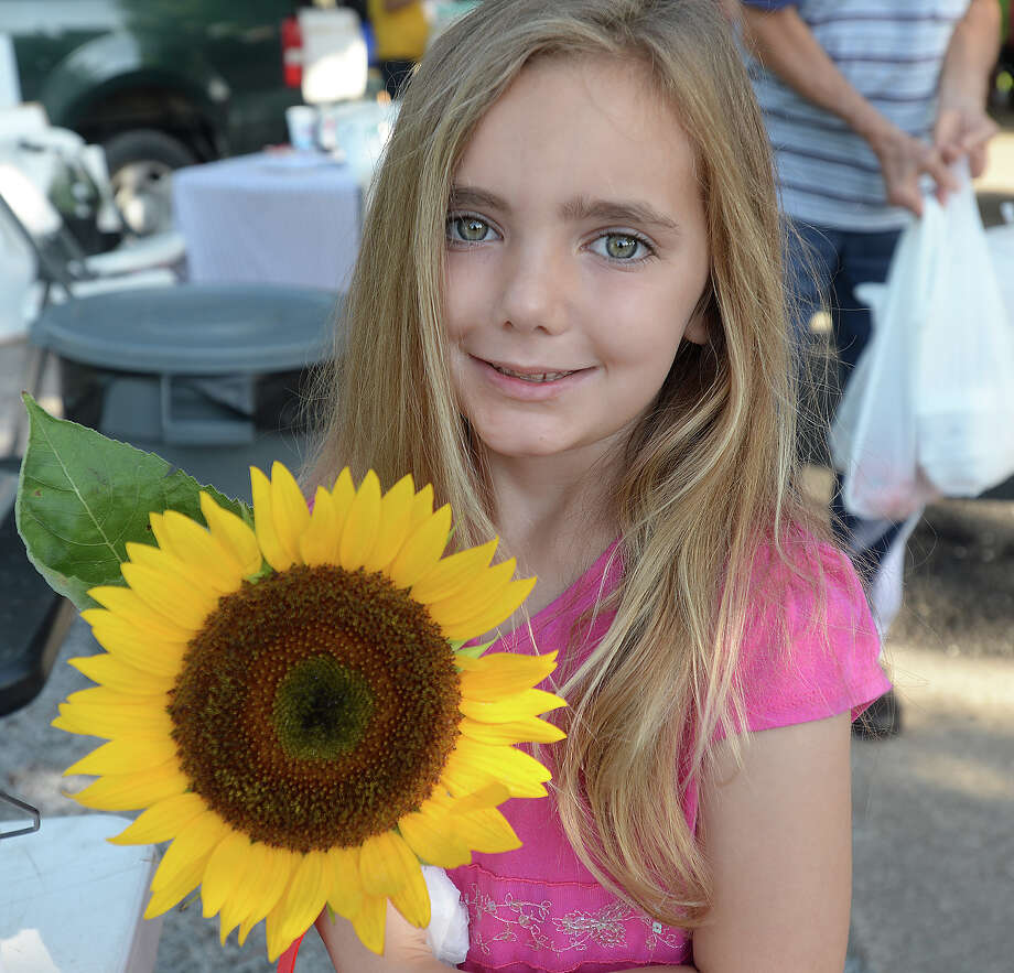 Reese McGowan, 6, was at the Beaumont Farmer's Market Saturday morning. As the growing season hits its peak for many fruits and vegetables, the crowd at the weekly market is hitting a peak of its own.