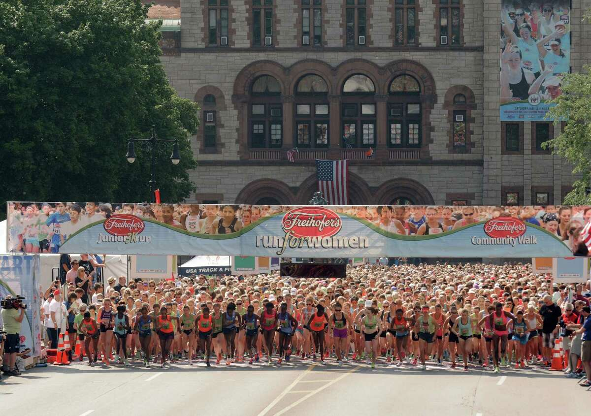 Runners break from the start of the 37th Annual Freihofer's Run for Women on Saturday May 30, 2015 in Albany, N.Y. (Michael P. Farrell/Times Union)