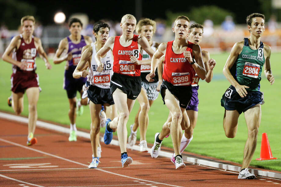 New Braunfels Canyon's Alex Rogers (third from right) amd teammate Samuel Worley run near the lead as the bell lap sounds in the 6A 1600-meter run during the UIL State track and field meet at Mike Myers Stadium in Austin on Saturday, May 16, 2015. Rogers won the event with a time of 4 minutes 15.87 seconds  Worley finished third with 4 minutes, 17.68 seconds.  MARVIN PFEIFFER/ mpfeiffer@express-news.net Photo: Marvin Pfeiffer, Staff / San Antonio Express-News / Express-News 2015