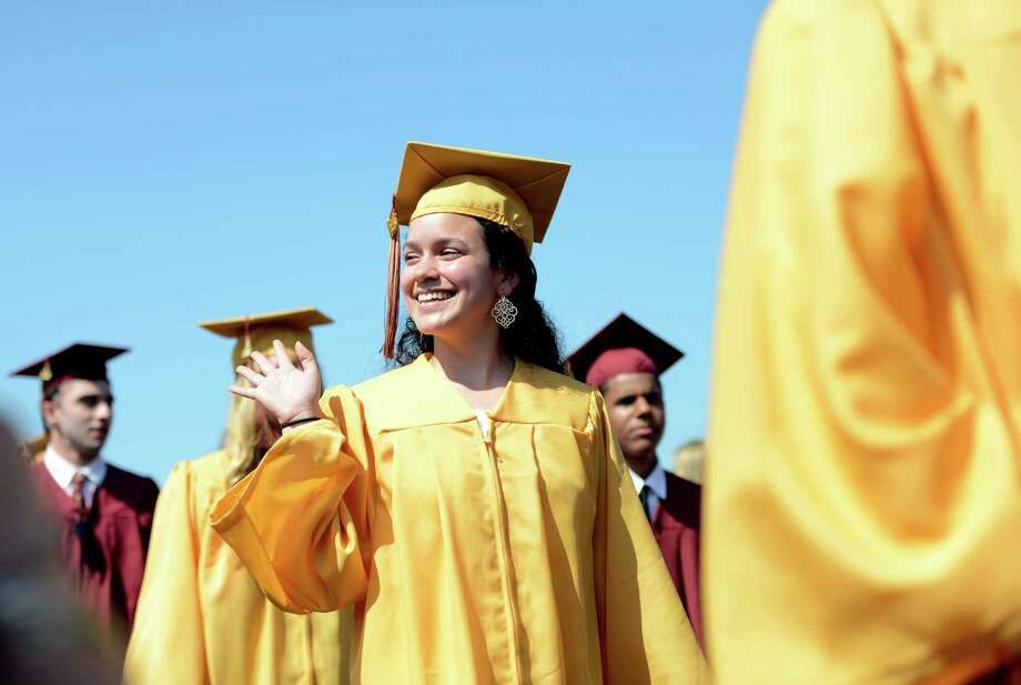 St. Joseph High School graduate Ashley Mackowski, of Shelton, waves to friend's during commencement exercises Saturday, May 30, 2015, at the school in Trumbull, Conn. Photo: Autumn Driscoll / Connecticut Post