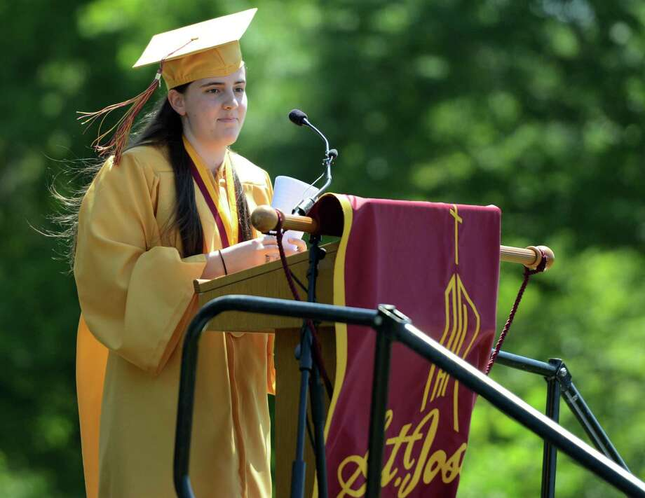 St. Joseph High School valedictorian Emily Robertson, of Stratford, addresses her fellow graduates during commencement exercises Saturday, May 30, 2015, at the school in Trumbull, Conn. Photo: Autumn Driscoll / Connecticut Post