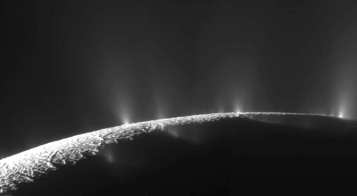 Enormous jets of ice erupt from the pole of Enceladus, one of Saturn's moons that could contain alien life.