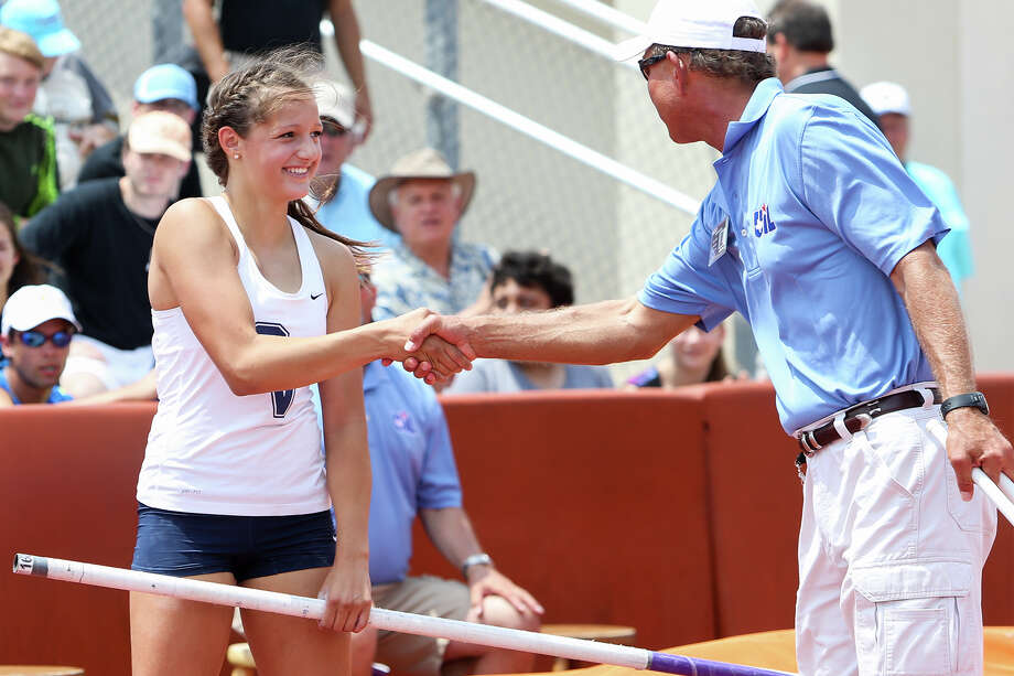 Smithson Valley's Colleen Clancy shakes hands with a track official after finishing her competition in the 6A pole vault during the UIL State track and field meet at Mike Myers Stadium in Austin on Saturday, May 16, 2015. Clancy took second plae in the event with a vault of 13 feet, 6 inches.  MARVIN PFEIFFER/ mpfeiffer@express-news.net Photo: Marvin Pfeiffer, Staff / San Antonio Express-News / Express-News 2015