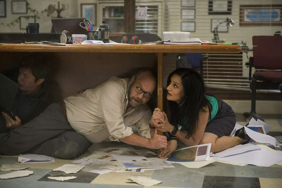 "This photo provided by Warner Bros. Pictures shows Paul Giamatti as Lawrence and Archie Panjabi as Serena, in a scene from the action thriller, ""San Andreas."" The movie releases in theaters on May 29, 2015.  (Jasin Boland/Warner Bros. Pictures via AP) Photo: Jasin Boland, Associated Press"